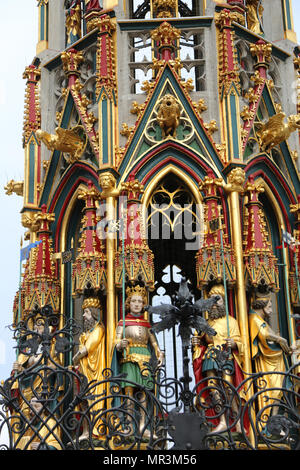 Nuremberg, Germany - August 15, 2017: Beautiful Fountain also called Schoner Brunnen in German Language with many figures of saints and famous people  - Stock Photo