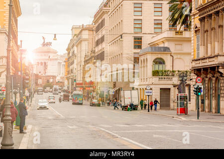 Rome, Italy, March 2017: view of Via Nazionale in Rome with the monument of the Fatherland in the background at sunset - Stock Photo