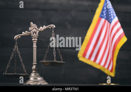 Law and Justice, Legality concept, Scales of Justice in front of the American flag in the background. - Stock Photo