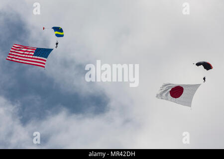 Evolve Aerosports executes a flag jump during the 41st Japan Maritime Self-Defense Force – Marine Corps Air Station Iwakuni Friendship Day at MCAS Iwakuni, Japan, May 5, 2017. Since 1973, MCAS Iwakuni has conducted a single-day air show and open house specifically designed to foster positive relationships between the air station and our Japanese hosts, and the event traditionally draws more than 200,000 visitors and participants. This year is the 41st Friendship Day, offering a culturally enriching experience that displays the mutual support that the U.S. and Japan share. This annual event sho - Stock Photo