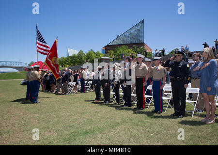 CHATTANOOGA, Tenn. – Attendees stand for the posting of the colors during a ceremony posthumously awarding the Navy and Marine Corps Medal to Gunnery Sgt. Thomas Sullivan and Staff Sgt. David Wyatt at Ross's Landing in Chattanooga, Tenn., May 7, 2017. Attendees of the ceremony included Maj. Gen. Burke W. Whitman, commanding general of 4th Marine Division, Sgt. Maj. Michael A. Miller, sergeant major of 4th MARDIV and family members of GySgt Thomas Sullivan and SSgt David Wyatt. (U.S. Marine Corps Photo by Lance Cpl. Niles Lee/Released) - Stock Photo