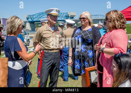 CHATTANOOGA, Tenn. – Maj. Gen. Burke W. Whitman, commanding general of 4th Marine Division, talks to Lorri Wyatt, wife of Staff Sgt. David Wyatt, and other family members at Ross's Landing in Chattanooga, Tenn., May 7, 2017.  Wyatt was posthumously awarded the medal for his actions during the July 16, 2015 shooting that occurred at the Naval Reserve Center Chattanooga and left two other Marines and a sailor dead. (U.S. Marine Corps Photo by Lance Cpl. Niles Lee/Released) - Stock Photo