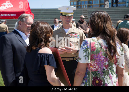 CHATTANOOGA, Tenn. – Maj. Gen. Burke W. Whitman, commanding general of 4th Marine Division, talks to the families of Gunnery Sgt. Thomas Sullivan and Staff Sgt. David Wyatt at Ross's Landing in Chattanooga, Tenn., May 7, 2017. Sullivan and Wyatt were posthumously awarded the medal for their actions during the July 16, 2015 shooting that occurred at the Naval Reserve Center Chattanooga and left two other Marines and a sailor dead. (U.S. Marine Corps Photo by Lance Cpl. Niles Lee/Released) - Stock Photo