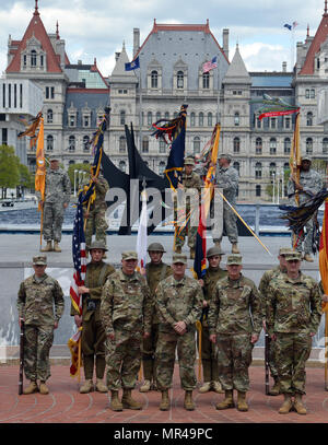 With the New York State Capitol in the background, key leaders of the New York Army National Guard and the 42nd Infantry Division pose following change of command ceremonies at the Empire State Plaza in Albany, N.Y. on May 6, 2017. They are, from left, Brig. Gen. Raymond Shields, Assistant Adjutant General for Army; Major General Harry Miller, the outgoing commander of the 42nd Infantry Division; Brig. Gen. Steven Ferrari, the incoming commander of the 42nd Infantry Division; and Command Sgt. Major Justin Lenz, 42nd Infantry Division Command Sgt. Major. ( U.S. Army National Guard photo by Lt.  - Stock Photo
