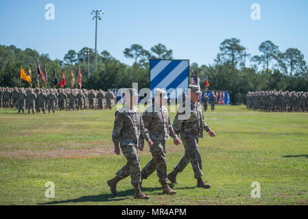 Maj. Gen. Leopoldo Quintas, left, incoming Commander of 3rd Infantry Division, Gen. Robert Abrams, center, Commander U.S. Forces Command, and Maj. Gen. James Rainey, right, outgoing Commanding General 3rd Infantry Division, complete the inspection of troops. The 3rd Infantry Division change of command ceremony was held on Cotrell Field at Fort Stewart, GA, May 8, 2017. (U.S. Army Photo by Lt. Col. Brian J. Fickel) - Stock Photo