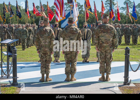 Maj. Gen. Leopoldo Quintas, left, incoming Commander of 3rd Infantry Division, Gen. Robert Abrams, center, Commander U.S. Forces Command, and Maj. Gen. James Rainey, right, outgoing Commanding General 3rd Infantry Division, stand in front of the assembled 3rd Infantry Division. The 3rd Infantry Division change of command ceremony was held on Cotrell Field at Fort Stewart, GA, May 8, 2017. (U.S. Army Photo by Lt. Col. Brian J. Fickel) - Stock Photo