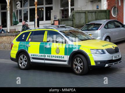 Rapid response NHS car ambulance vehicle in use.