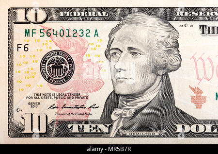 Ten dollars bill fragment of U.S. money in macro. - Stock Photo