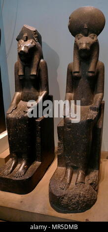 Black granite statues of the goddess Sakhmet, from the Temple of Mut, Thebes, Egypt. circa 1400 BC. In Egyptian mythology, Sekhmet was a warrior goddess as well as goddess of healing - Stock Photo