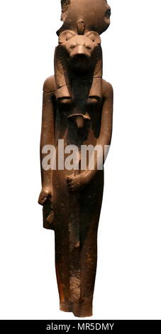 Black granite statue of the goddess Sakhmet, from the Temple of Mut, Thebes, Egypt. circa 1400 BC. In Egyptian mythology, Sekhmet was a warrior goddess as well as goddess of healing - Stock Photo