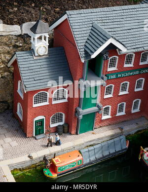 Canal life with canal boat, in the model village at Bekonscot, Buckinghamshire, England, the oldest  model village in the world. - Stock Photo