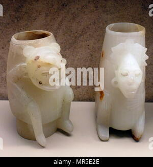 Carved and polished Onyx (tecali) vessels with a seated figures. Post-Classic Date900-1521. Found at Isla de Sacrificios, tomb, Veracruz, Mexico - Stock Photo