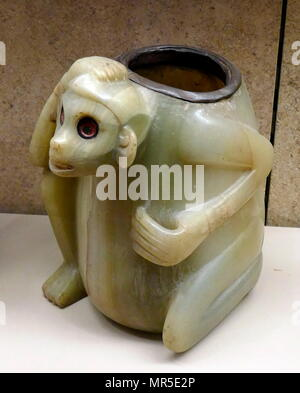 Carved and polished Onyx (tecali) vessel with a seated figure. Post-Classic Date900-1521. Found at Isla de Sacrificios, tomb, Veracruz, Mexico - Stock Photo