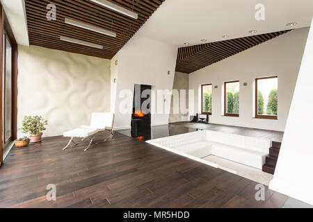 Relaxing area with lounge chair and white 3d wall - Stock Photo