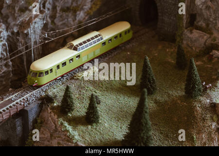 Mountain railway with vintage train on the miniature model. - Stock Photo