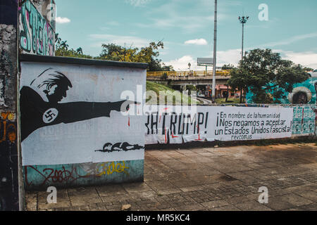 Anti-Trump graffiti on a wall in Cali, Colombia, that reads in Spanish, 'In the name of humanity, we refuse to accept a fascist United States' - Stock Photo
