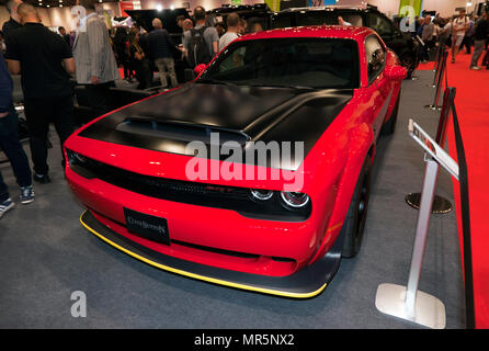 Three-quarter front view of a Dodge Challenger  SRT Demon, on the Clive Sutton Stand, at the 2018 London Motor Show - Stock Photo