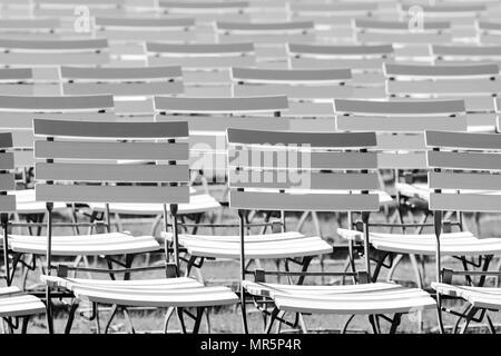 White chair rows in a spa park in Black & White medium light - Stock Photo