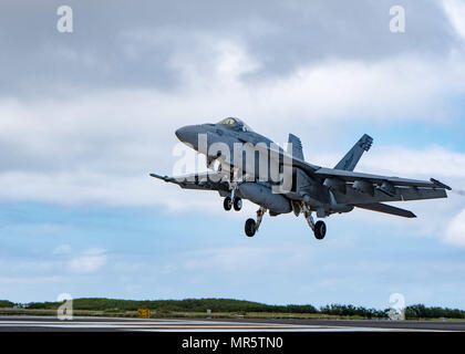 170508-N-YD204-053  IWO TO, Japan (May 8, 2017) An F/A-18F Super Hornet assigned to the 'Dambusters' of Strike Fighter Squadron (VFA) 195 practices a touch-and-go landing during field carrier landing practice qualifications in Iwo To, Japan. VFA-195 is part of Carrier Air Wing (CVW) 5, providing a combat-ready force that protects and defends the collective maritime interest of the U.S. and its allies and partners in the Indo-Asia-Pacific region. (U.S. Navy photo by Mass Communication Specialist 3rd Class Matthew C. Duncker/Released) - Stock Photo