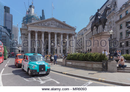 Threadneedle Street in the City of London. In the foreground is a London Hackney cab covered in blue advertising. - Stock Photo