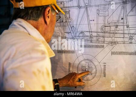 Dorian Walker, Chairman of Friends of Jenny, looks over and studies blueprints, May, 4, 2017 at Bowling Green, Kentucky. FOJ's mission was to build a Jenny-but to build it to fly. They wanted to do it in a short amount of time and not spend anywhere from 7 to 20 years building it and it not fly, so 5,720 hours later, over the course of 14 months, three teams of individuals built the Jenny. (U.S. Air Force photo/Senior Airman Tristin English) - Stock Photo