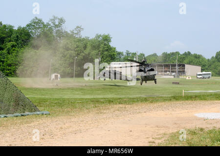 Two UH-60 Black Hawk helicopters prepare to land as part of a training exercise May 11, 2017, at Fort Campbell, Kentucky. The helicopters were part of a scenario for the field feeding portion of the Philip A. Connelly Program. Soldiers assigned to E Company, 6th Battalion, 101st General Support Aviation Battalion, 101st Combat Aviation Brigade, 101st Airborne Division, won the division competition in March and then competed at the corps level. - Stock Photo
