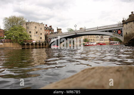 A gloomy day out in York with lendal bride in the background close up of the river - Stock Photo