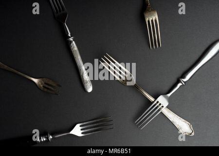 Vintage metallic cutlery and kitchen utensils on gray background - Stock Photo