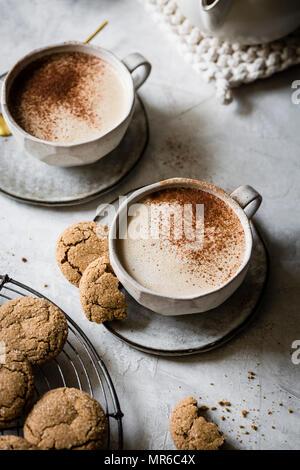 Vegan Cashew Gingersnap Lattes with ginger cookies - Stock Photo