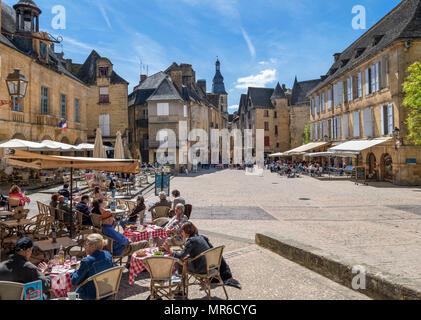 Cafes on Place du Marché aux Oies and Place de la Liberte in the old town, Sarlat, Dordogne, France - Stock Photo