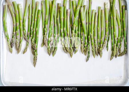 Asparagus on a baking tray - Stock Photo