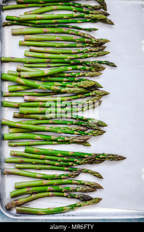 Asparagus on a baking tray - Stock Photo
