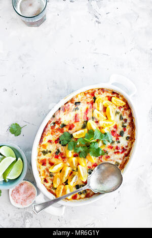 Spaghetti Squash Enchilada Casserole served with Cilantro Salsa - Stock Photo