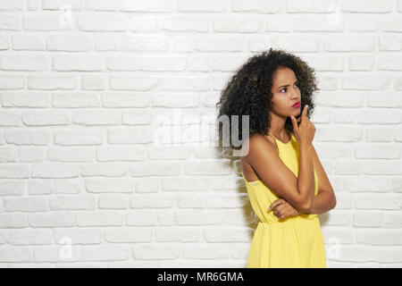 Portrait of puzzled woman having doubts, doubtful black girl thinking. Copy space - Stock Photo