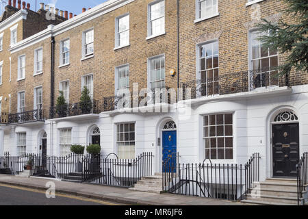 Stucco fronted facades of upmarket residential townhouses in Alexander Place, Kensington, London, England, UK - Stock Photo