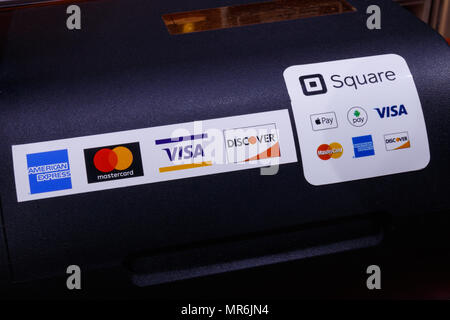 Indianapolis - Circa May 2018: Modern mobile credit methods including Square, Apple Pay, Android Pay, Visa, Master Card, American Express and Discover - Stock Photo