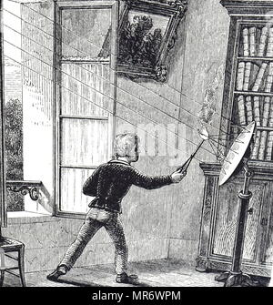 Engraving depicting a boy lighting paper using the sun's rays focused by a concave mirror. Dated 19th century - Stock Photo