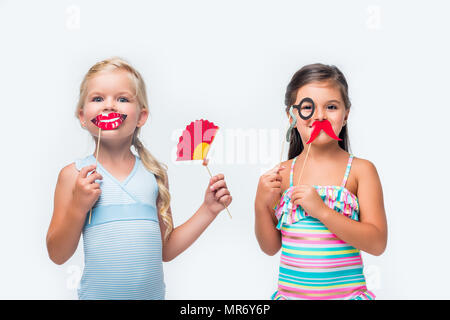 e851b4e709 ... adorable little girls in swimsuits holding party sticks and looking at  camera isolated on white -