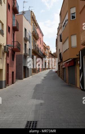 Sleepy back street Carrer de la Roda in the seaside town of Palamos on the Spanish Costa Brava - Stock Photo