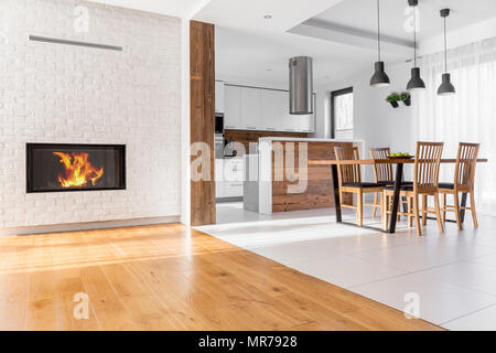 Open plan home with living room, kitchen and dining area - Stock Photo
