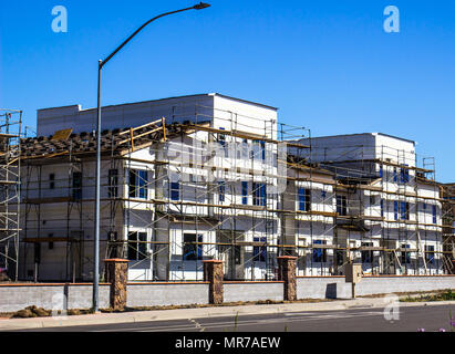 Brand New Apartment Building Construction With Scaffolding - Stock Photo