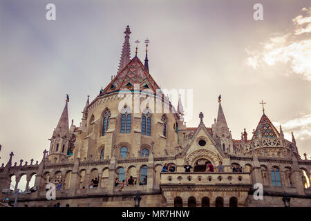 Budapest, Hungary - September 19, 2015: People visit the Fisherman's Bastion in Budapest, Hungary at sunset time - Stock Photo