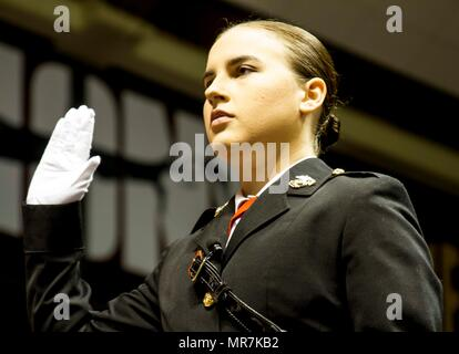 """Mary Sanders raises her hand and takes the Oath of Office in order to become a second lieutenant in the United States Marine Corps during her commissioning ceremony at Coleman Coliseum, May 12, 2017. Sanders is a recent graduate of Alabama State University and attended Platoon Leaders Course and Officer Candidate School before being commissioned. """"After a couple of weeks I saw how the Marine Corps worked and was hooked. I was so inspired and motivated that if I had any doubts before, they were gone. This was something I wanted to be a part of."""" (U.S. Marine Corps photo by Cpl. Krista James/Rel - Stock Photo"""