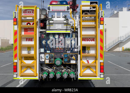 The rear od a fire engine with the various dials and equipment controls