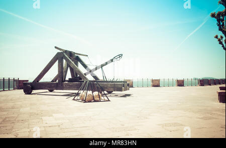 ancient catapult on the ramparts of Alghero in spring - Stock Photo