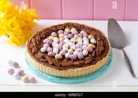 Chocolate egg tart with chocolate eggs - Stock Photo
