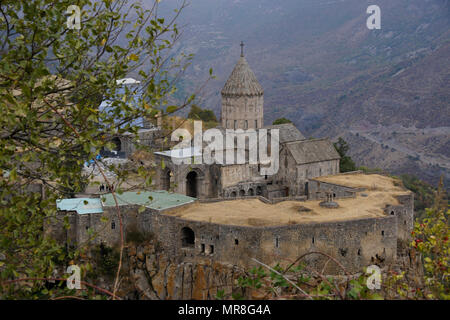 Tatev Monastery with the church of Surp Poghos-Petros (St. Paul and St. Peter) sits on the edge of Vorotan Canyon on a cloudy day in autumn, Armenia - Stock Photo