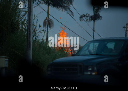 A molten lava fountain spews liquid magma hundreds of feet into the air at the Leilani Estates residential area from the eruption of the Kilauea volcano May 23, 2018 in Pahoa, Hawaii. - Stock Photo