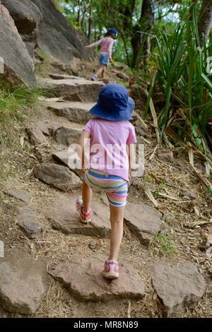 Young girls walking along Cudtheringa track, Castle Hill QLD 4810, Australia - Stock Photo