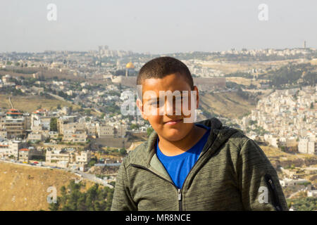 8 May 2018 young Jewish boys sitting together to have his photograph taken at his own request on a hillside in the suburbs of Jerusalem Israel - Stock Photo